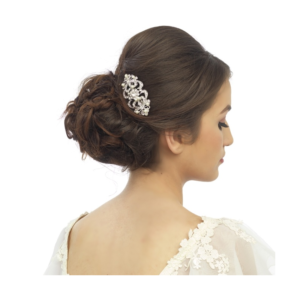Chic hair comb in a vintage inspired design with ivory simulated pearls and clear crystals on a silver tone finish - measures approx 6.5cm long